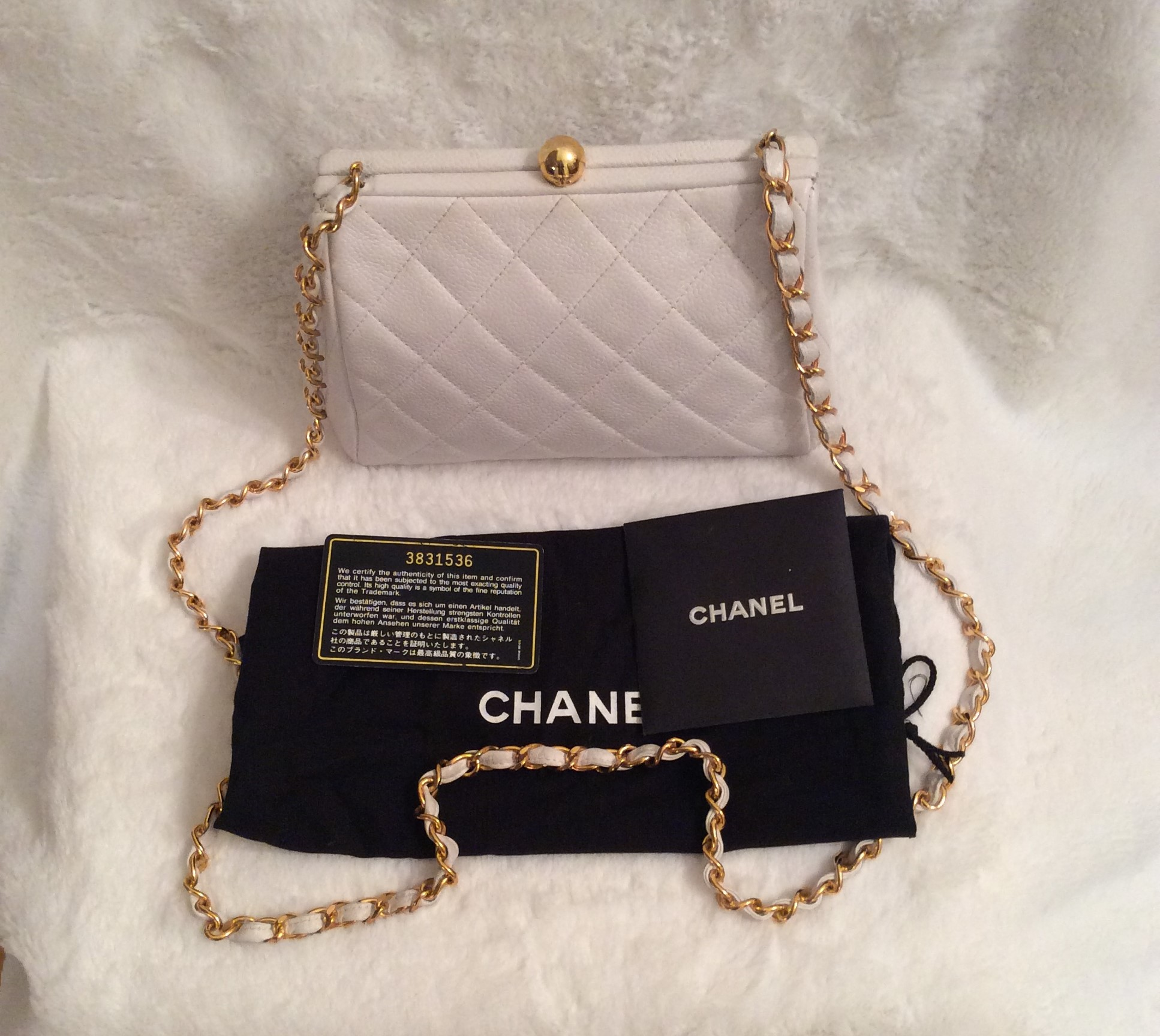 2485f7277e3b Chanel  Authentic Vintage Small White Quilted Caviar Leather Large CC Logo  on Bottom Handbag with Long Chain Link Leather Shoulder Strap and Gold Logo  ...