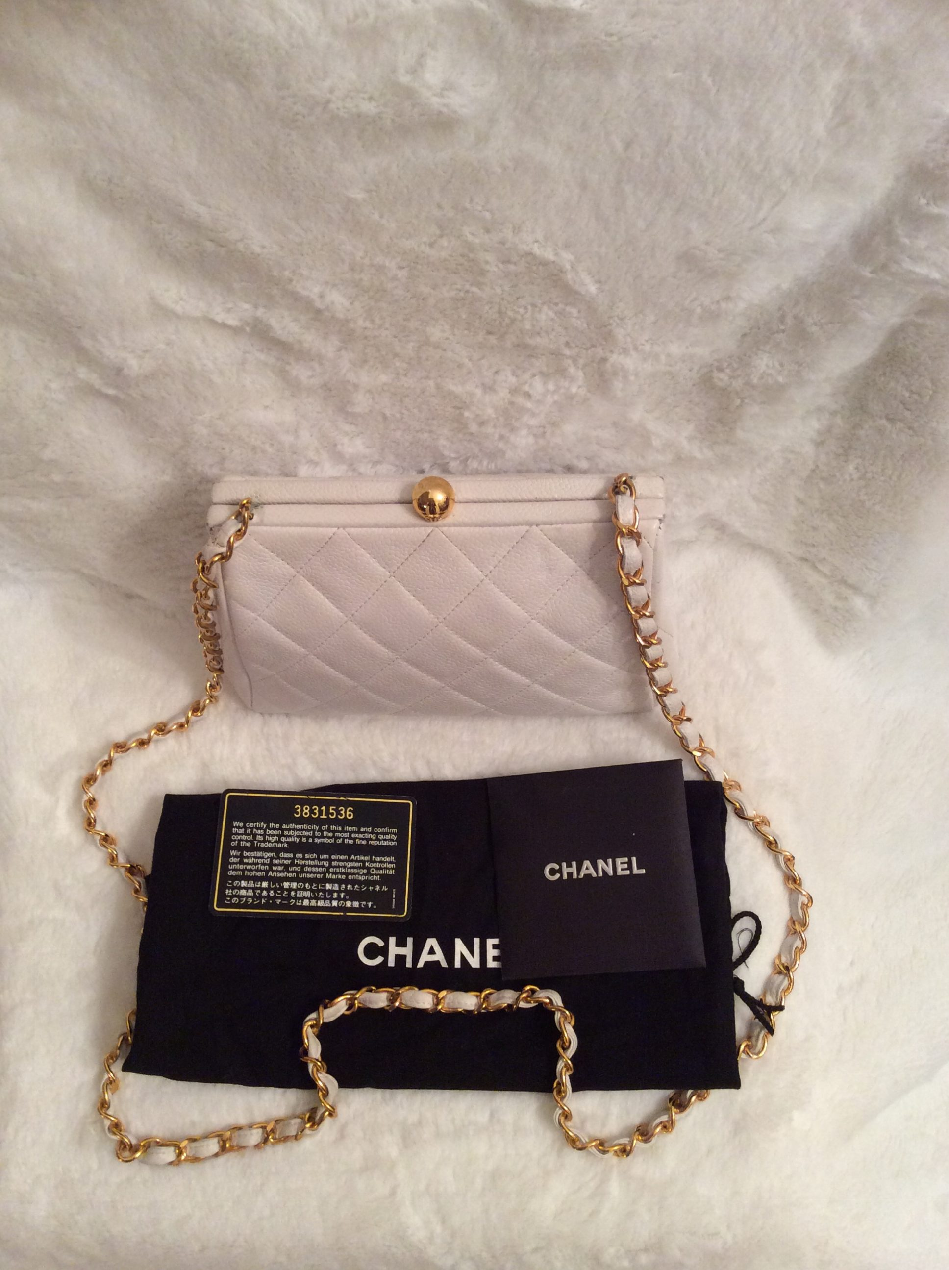 ffc894beec7c Chanel  Authentic Vintage Small White Quilted Caviar Leather Large CC Logo  on Bottom Handbag with Long Chain Link Leather Shoulder Strap and Gold Logo  ...