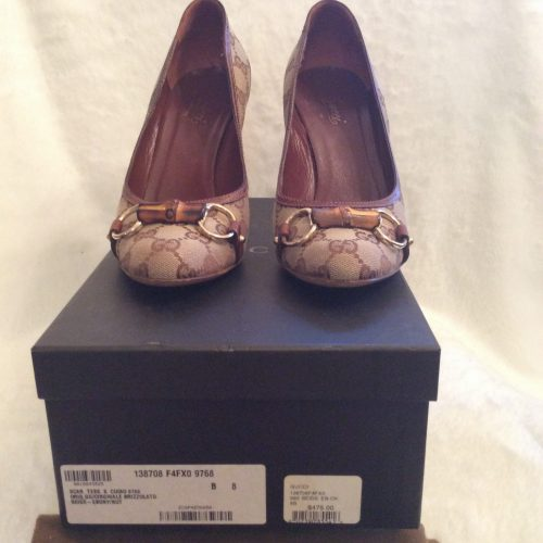 12b301ec5ef Gucci  Authentic Classic Brown Canvas Fabric Leather Monogrammed GG  Stiletto Heels Embellished with Gold Horsebit Hardware and Center Bamboo on  Top of ...